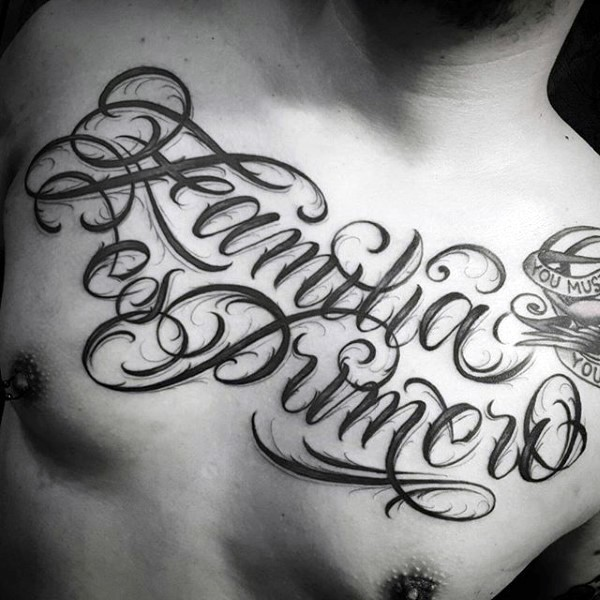Simple designed black ink big lettering tattoo on chest