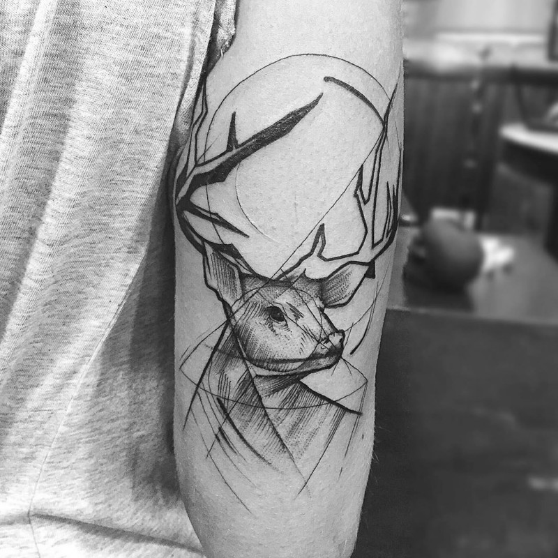 Simple designed black ink deer tattoo on arm muscle