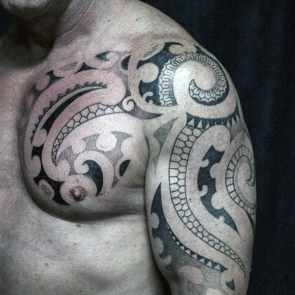 Simple designed black ink Polynesian tattoo on shoulder and chest