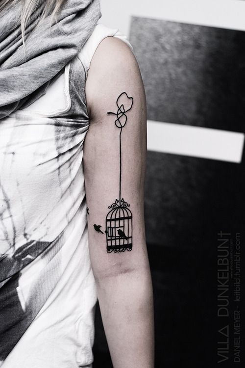 Simple designed black ink roped bird cage tattoo on shoulder
