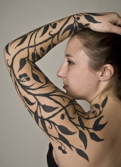 Simple designed black ink tree leaves sleeve tattoo