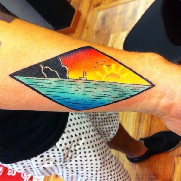 Simple designed colorful ocean with little ship tattoo on wrist