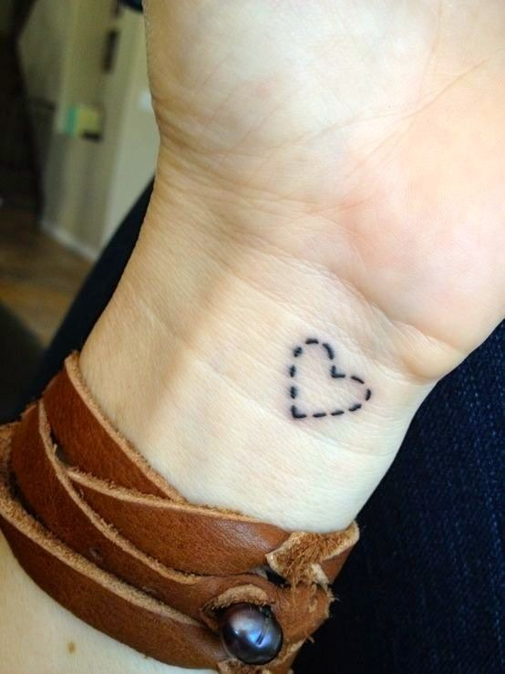 Simple dotted line heart tattoo on wrist