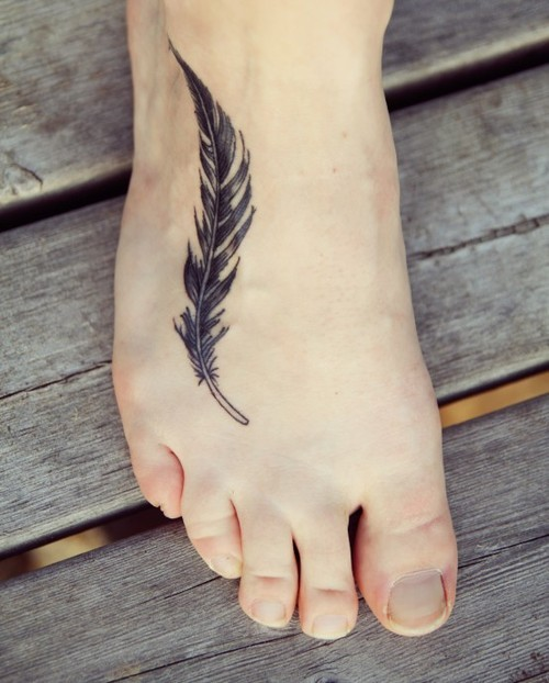 Simple feather ink black foot tattoo for Simple foot tattoos