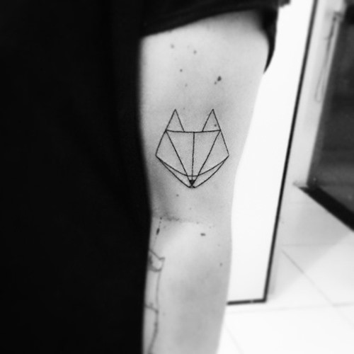 Simple geometrical style black ink arm fox shaped tattoo