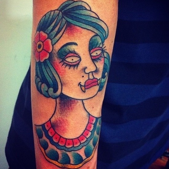 Simple homemade carelessly painted vampire woman portrait tattoo on forearm