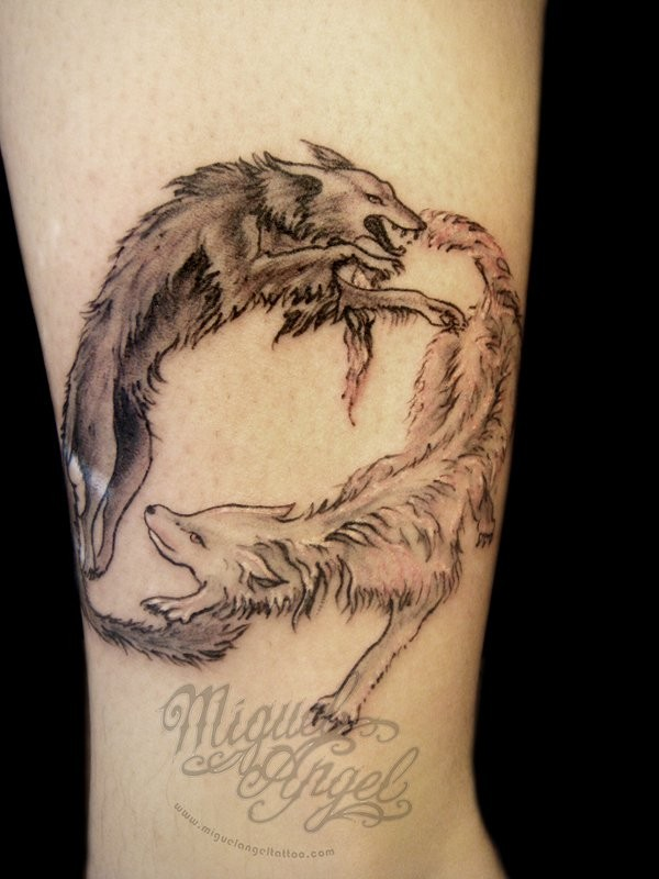 Simple homemade colored circle shaped fighting wolves tattoo