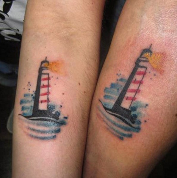 Simple homemade colored tiny lighthouse tattoo on forearm zone