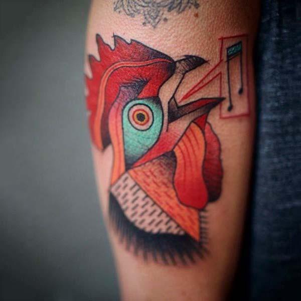 Simple homemade like colored cock tattoo on arm
