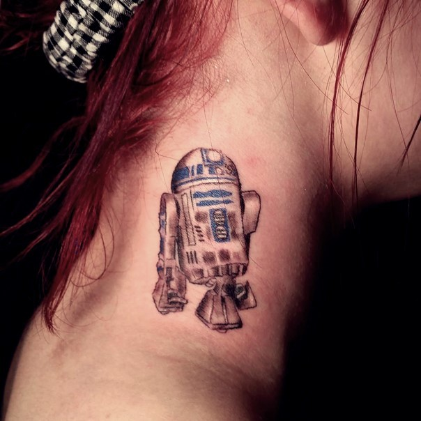 Simple homemade like colored Star Wars R2D2 droid tattoo on neck