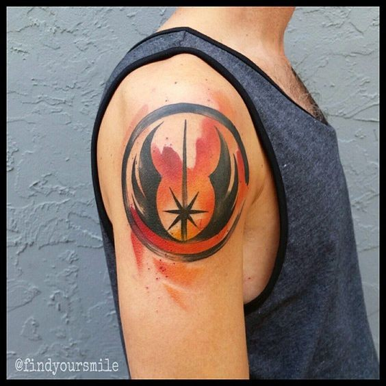 Simple homemade like watercolor painted Jedi symbol tattoo on shoulder