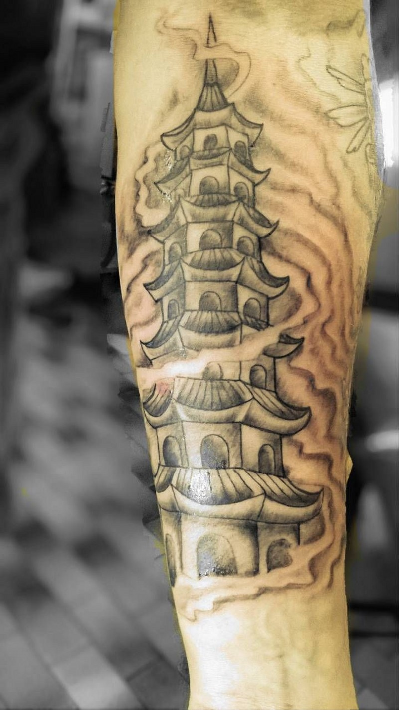 Simple homemade style black ink forearm tattoo of ancient temple in fog