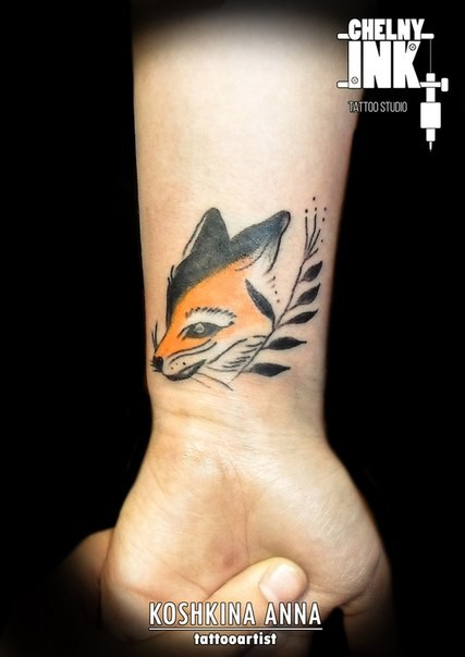 Simple homemade style colored wrist tattoo of big fox head with plant branch
