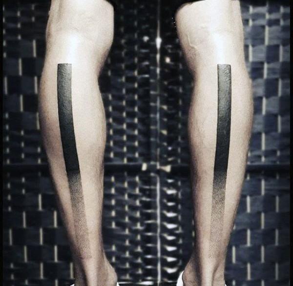 Simple identical looking leg tattoos of black lines