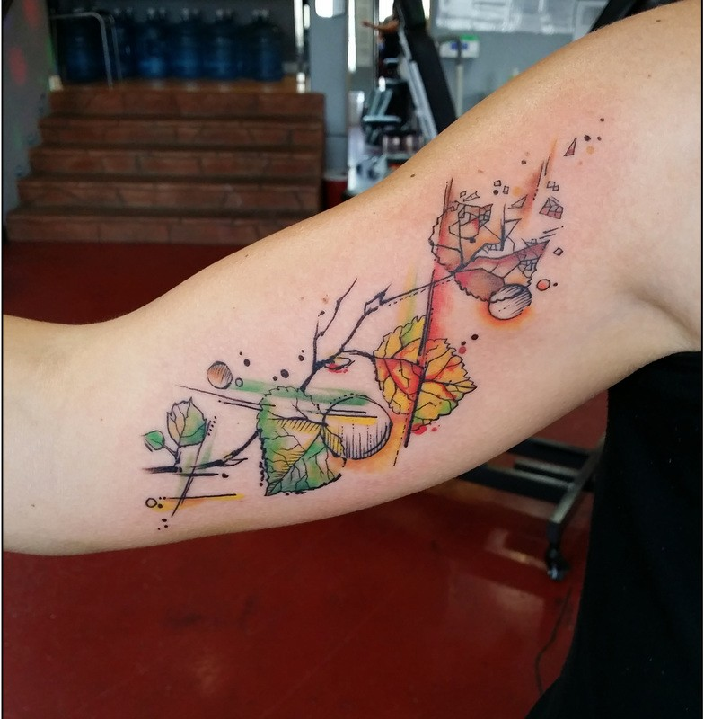 Simple illustrative style colored biceps tattoo of leaves