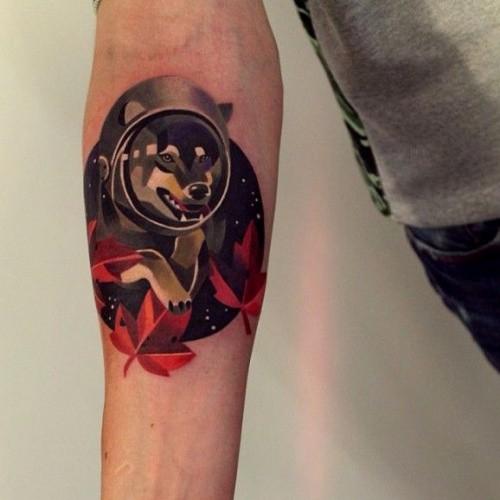 Simple illustrative style forearm tattoo of wolf astronaut