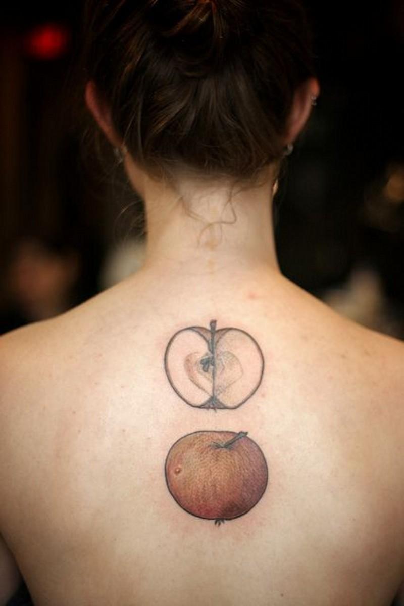Simple little apple and half of apple tattoo on back