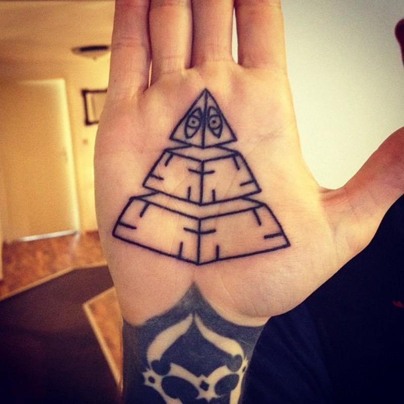 Simple little black ink pyramid tattoo on hand