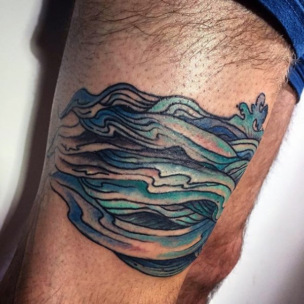 Simple little blue colored wave tattoo on thigh