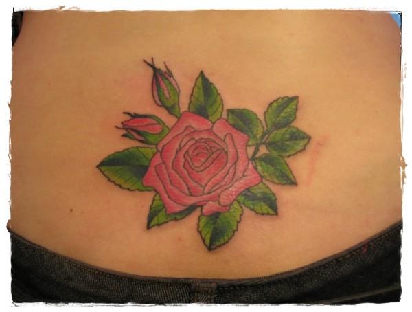 Simple little pink rose tattoo on waist