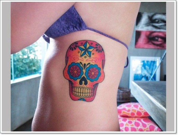 Simple mexican skull tattoo on ribs