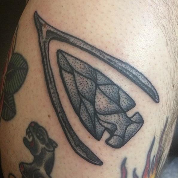 Simple old school black ink antic weapon tattoo