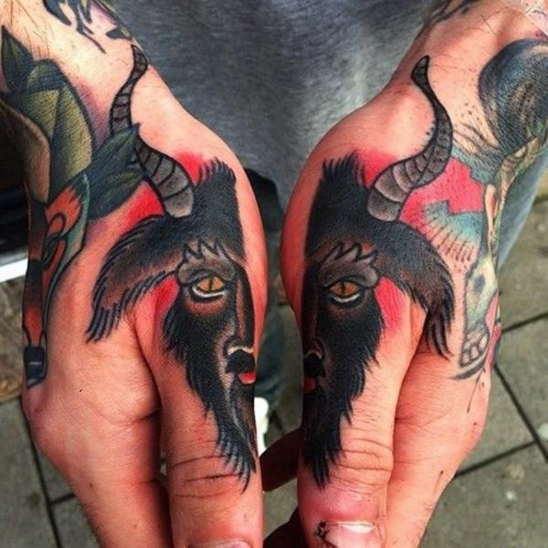 Simple old school painted divided goat head tattoo on hands