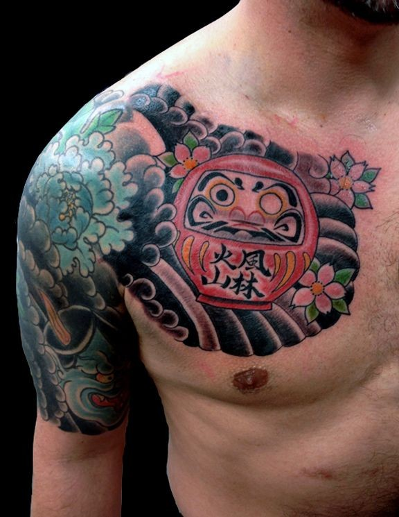 Simple Old School Style Chest Tattoo Of Daruma Doll With Flowers And