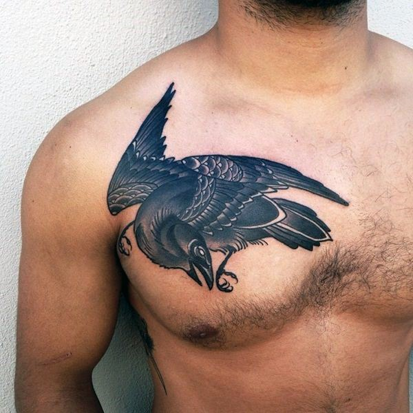 Simple painted big black and white detailed crow tattoo on chest