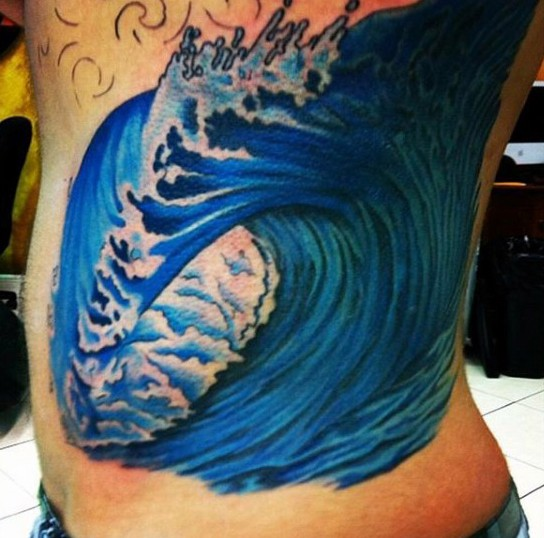 Simple painted big colored wave tattoo on side