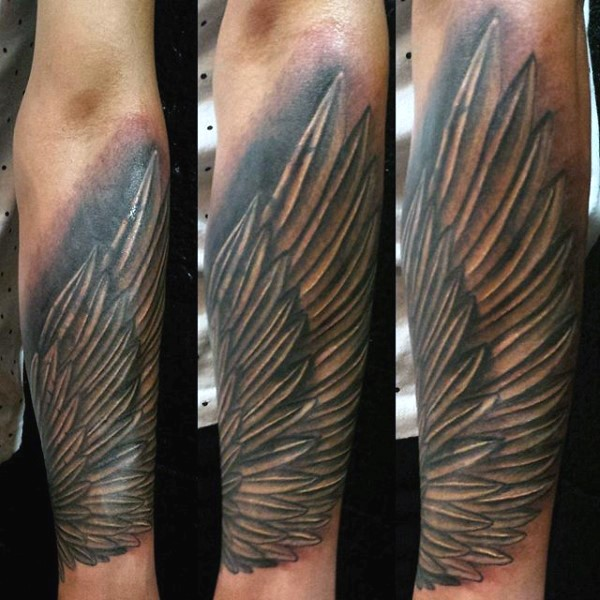 Simple painted black and white wing tattoo on arm for Wing forearm tattoo