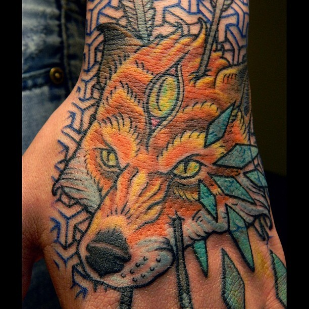 Simple painted colored fantasy fox with arrows tattoo on arm