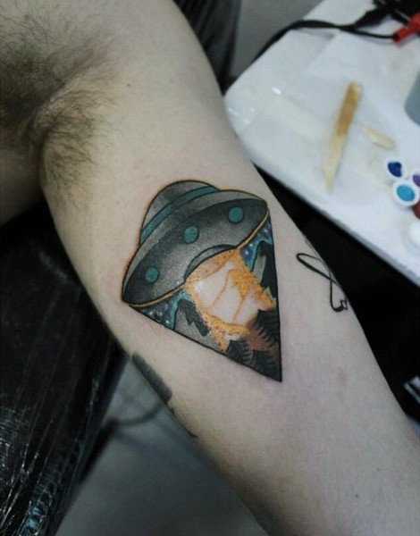 Simple painted colorful tiny alien ship tattoo on arm