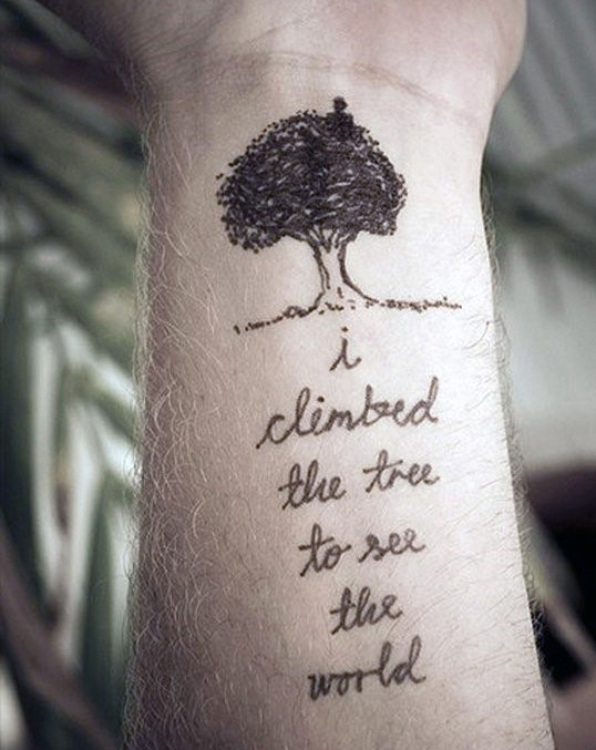 Simple romantic style black ink tree with lettering tattoo on wrist