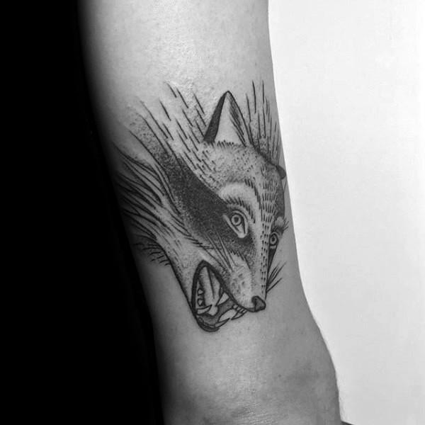 Simple sketch style arm tattoo of evil fox head