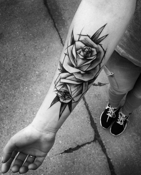 Simple sketch style black ink rose flowers tattoo on forearm