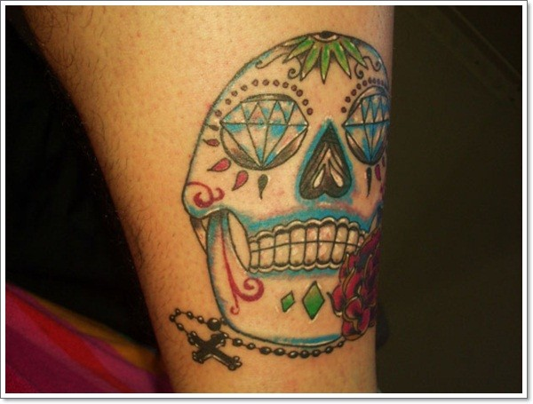 Simple sugar skull tattoo on leg