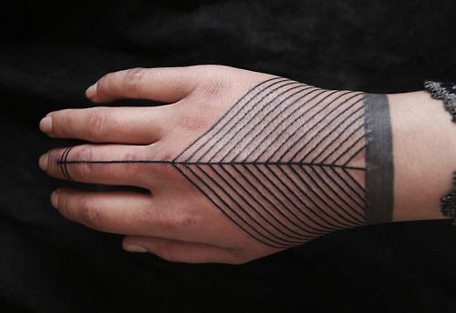 Simple tribal style black ink ornament tattoo on hand