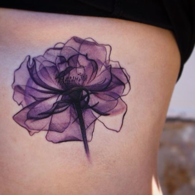 Simple violet colored flower tattoo on side