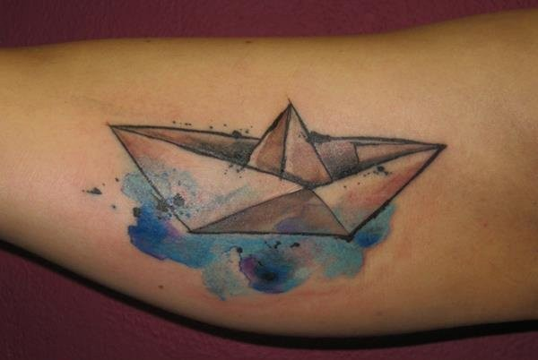 Simple watercolor style arm tattoo of paper ship