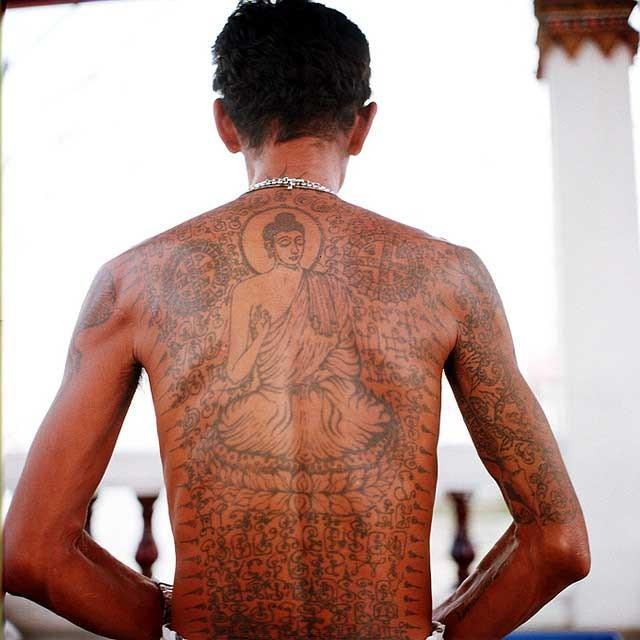 Sitting Buddha And Buddhist Symbols Tattoo On Back Tattooimages Biz