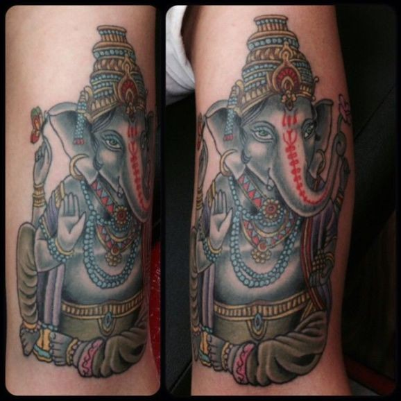 Sitting ganesha tattoo by Damion Ross