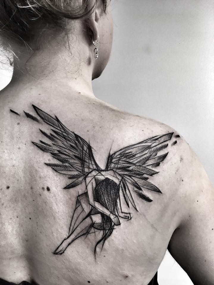 Sketch like black ink scapular tattoo painted by Inez Janiak angel