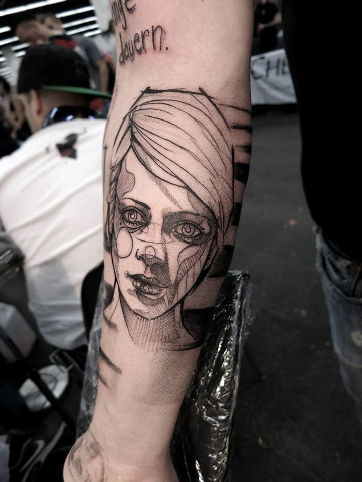 Sketch style black ink arm tattoo of woman with lettering