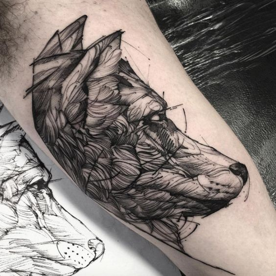 Sketch style black ink biceps tattoo of big wolf head