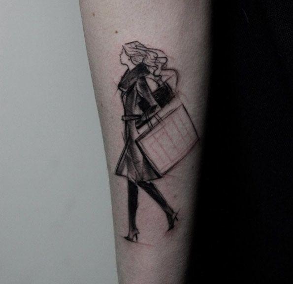 Sketch style black ink forearm tattoo of walking woman