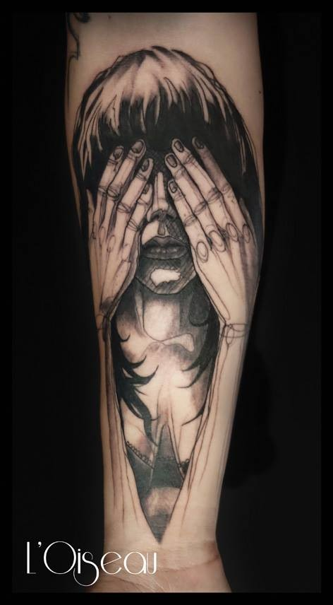 Sketch style black ink forearm tattoo of sad woman