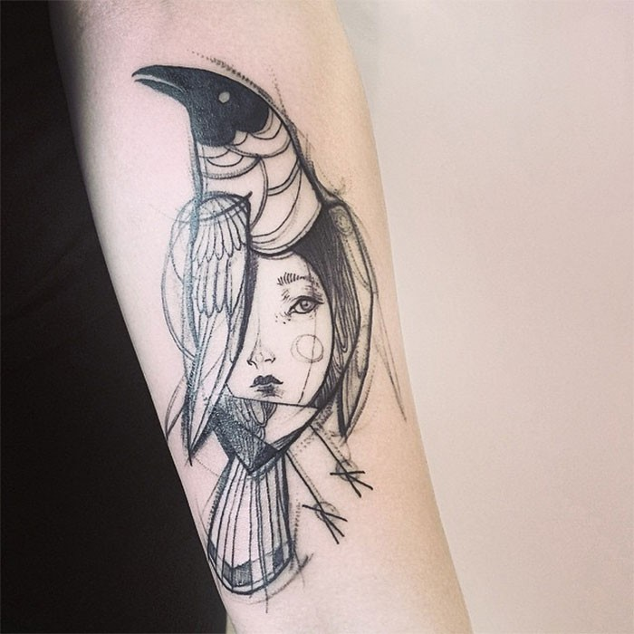 Sketch style black ink forearm tattoo of crow with woman face