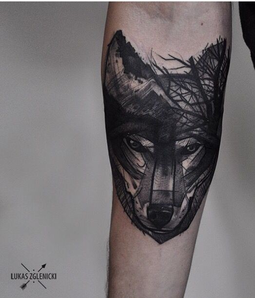Sketch style black ink forearm tattoo of wolf head