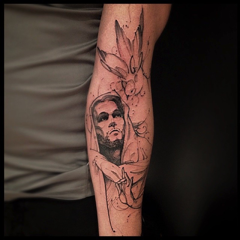 Sketch style black ink Jesus tattoo on sleeve